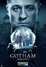 Commissioner Gordon from Gotham holding a Crystal Ball