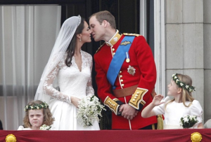 Prince William kisses his bride for the audience